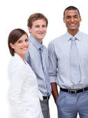 Smiling multi-ethnic business standing together — Stock Photo