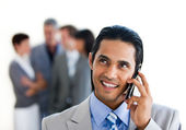 Focus on a smiling businessman on phone — Stock Photo