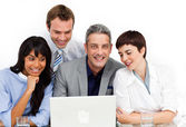 A diverse business group using a laptop — Stock Photo