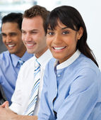 Multi-ethnic young business team sitting in a row — Stock Photo