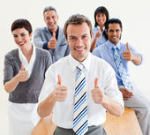 Fortunate business with thumbs up — Stock Photo