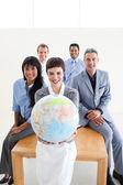 Confident business holding a terrestrial globe — Stock Photo