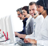 Confident customer service representatives with headset on — Stok fotoğraf