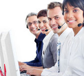 Multi-ethnic customer service representatives with headset on — Stock Photo