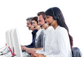 Concentrated customer service representatives with headset on — Stock Photo
