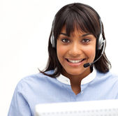 Smiling customer service representative using headset — Stock Photo