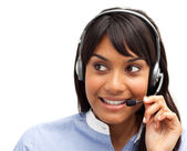 Attractive ethnic customer service representative using headset — Stock Photo