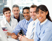 Portrait of multi-ethnic business team at work — Stockfoto
