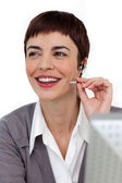 Self-assured businesswoman with headset on — Stock Photo