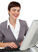 Positive female executive working at her computer — Stock Photo