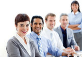 Smiling business co-workers sitting in a line — Stock Photo