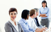 Attractive businesswoman in a meeting with her colleagues — Stock Photo