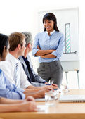 Self-assured businesswoman presenting to her team — Stock Photo