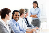 Charming businessman looking at the camera in a meeting — Stock Photo