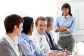Confident businesswoman with folded arms doing a presentation — Stock Photo