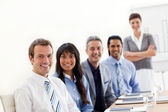 A business group showing ethnic diversity at a presentation — Stock Photo