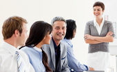 Glowing businesswoman presenting to her team — Stock Photo