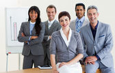 Cheerful multi-ethnic business around a conference table — Stock Photo