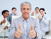 Mature manager celebrating a sucess with his team — Stock Photo