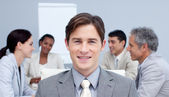Portrait of an attractive busienssman smiling in a meeting — Stock Photo