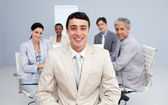 Young businessman smiling in a meeting — Stock Photo