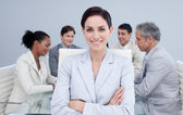 Confident businesswoman smiling in a meeting — Stock Photo