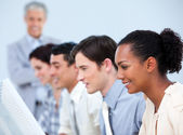 Multi-ethnic business at work with their manager — Stock Photo