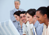 International business team at work with their manager — Stock Photo