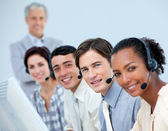 Cheerful business team working in a call center — Stock Photo