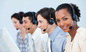 Multi-ethnic business using headset — Stok fotoğraf
