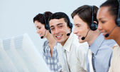 Young customer service representatives in a call center — Stok fotoğraf