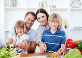 Happy family preparing dinner together — Stock Photo