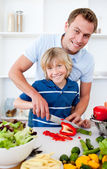 Cheerful father and his son cooking — Stock Photo