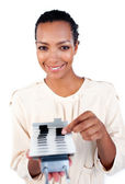 Self-assured businesswoman consulting a business card holder — Stock Photo