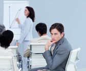 Bored charming businessman at a presentation — Stock Photo