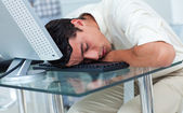 Tired businessman sleeping at his desk — Stock Photo