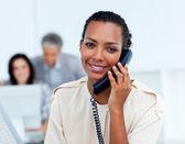 Charming businesswoman talking on phone — Stock Photo