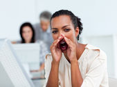 Afro-american businesswoman yelling in the office — Stock Photo