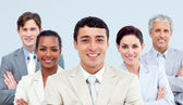 Multi-ethnic business standing with folded arms — Stock Photo