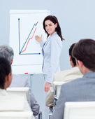 Beautiful businesswoman reporting sales figures — Stock Photo