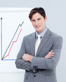 Confident businessman reporting sales figures — Stock Photo