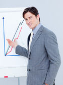 Handsome businessman reporting sales figures — Stock Photo