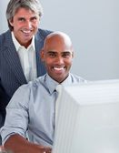Two elegant businessmen working at a computer — Stock Photo