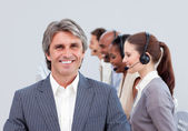 Cheerful manager in front of his team — Stock Photo