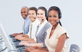 International customer service representatives using headset — Stock Photo