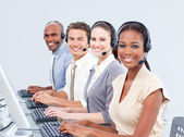 Multi-ethnic customer service representatives using headset — Stock Photo