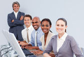 Happy customer service representatives in a call-center — Stock Photo