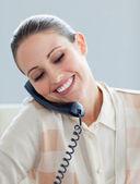 Assertive businesswoman talking on phone — 图库照片