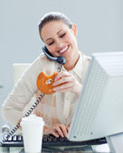 Confident businesswoman on phone eating a donnut — Stock Photo