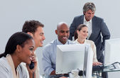 Confident business team at work — Stock Photo